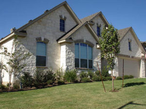 House finished in Austin Cream